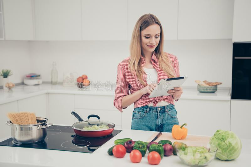 Close up photo beautiful amazing she her lady hold hands arms e-reader write type new recipe while food prepare homey stock photography
