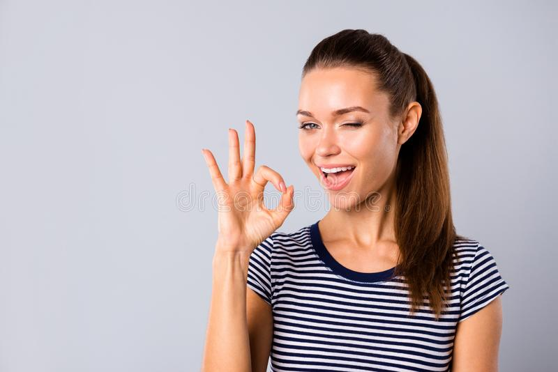 Close up photo beautiful amazing she her lady show ideal teeth self-confident okey symbol hand arm blink eye advising. Buy buyer new product wear blue white stock photography