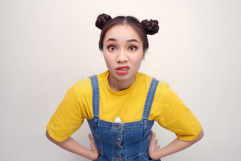 Close up photo beautiful amazing she her lady two hair buns ugh facial expression look disgusted side empty space wear casual t-. Shirt jeans denim overalls stock images