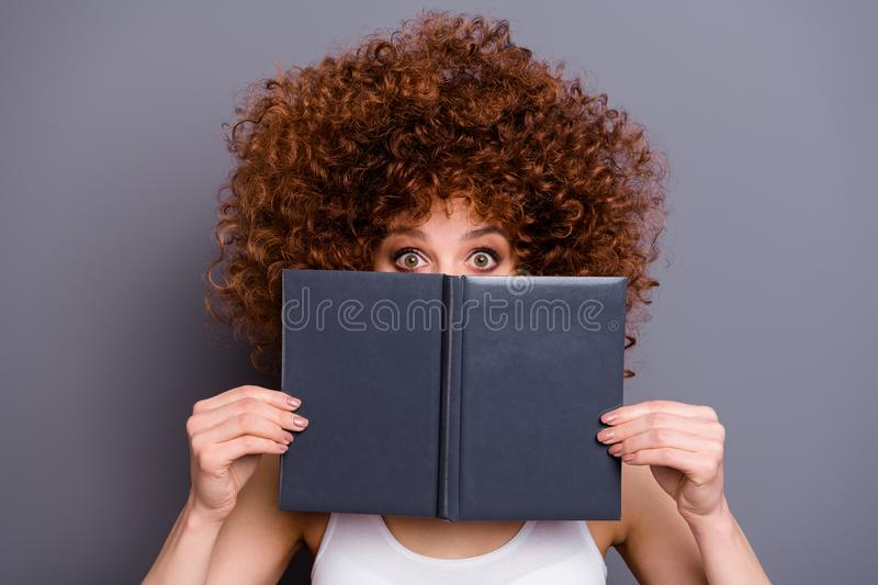 Close up photo of beautiful foxy lady book reader hide facial emotions shy person wear white tank-top isolated grey. Close up photo of beautiful foxy lady,book stock photography