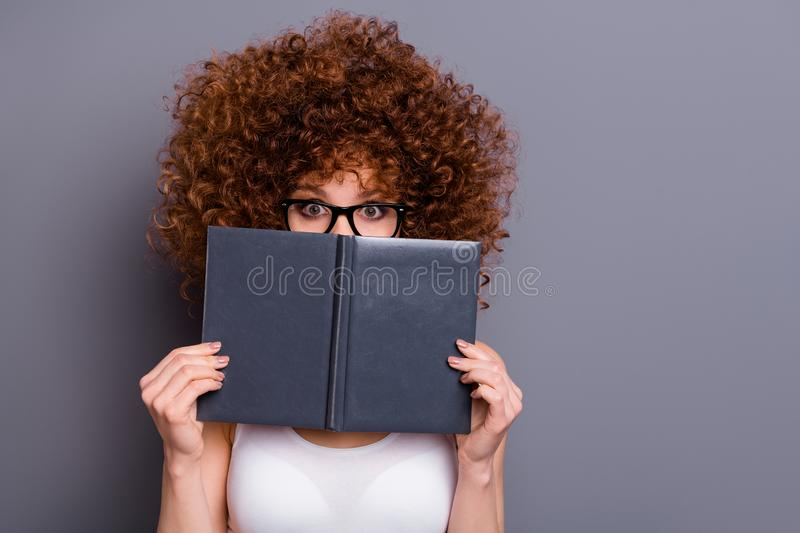 Close up photo of beautiful foxy lady reader hide facial emotions shy person wear specs white tank-top isolated grey. Close up photo of beautiful foxy lady royalty free stock photo