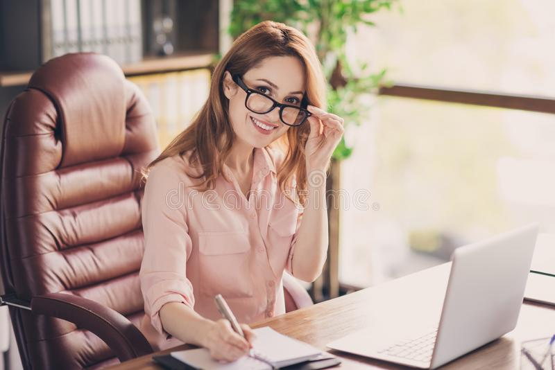 Close up photo beautiful she her business lady best boss having online interview noticing candidate qualities friendly. Chief notebook on table sit big office royalty free stock photography