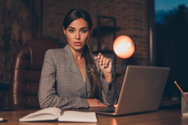 Close up photo beautiful she her business lady best chief attentively look new candidate resume moments noticing. Notebook table sit big office chair wearing royalty free stock photo