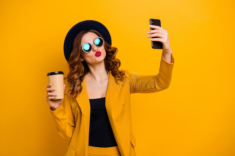Close up photo beautiful she her lady send air kiss hands arms telephone make take selfies vacation traveler hot. Beverage paper container wear specs formal stock images