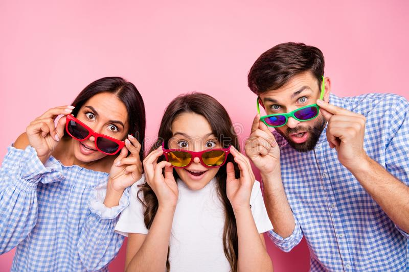 Close up photo of beautiful mom dad girl with brunette curly hair touch their eyewear eyeglasses wear plaid shirt royalty free stock photos