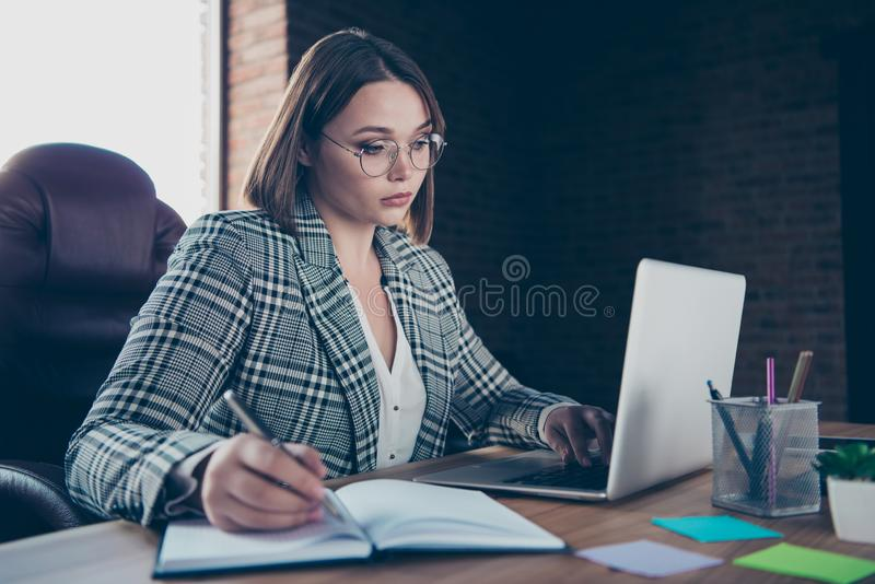 Close up photo beautiful strict she her business lady chief use user modern technologies noticing corporate company. Novelty notebook table sit big office chair stock images