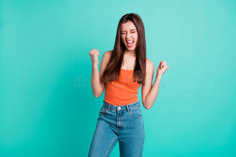 Close up photo beautiful yelling yeah her she lady hold arms hands fists raised air champion football competition wear royalty free stock images