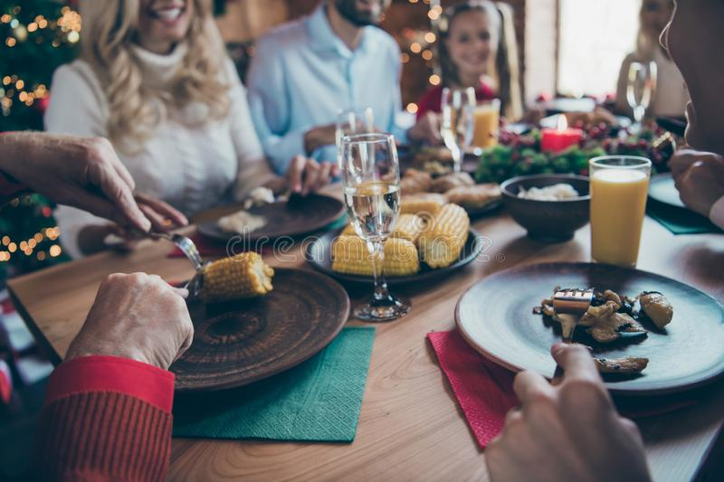 Close up photo of big large family ready to meet new year eating festive food enjoying company of each other of son. Daughter grandparents, granddaughter stock photos