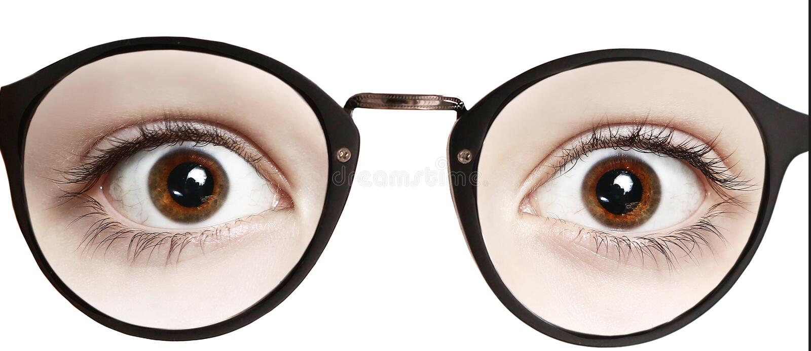 Close up photo of boy eyes wide open in glasses royalty free stock image