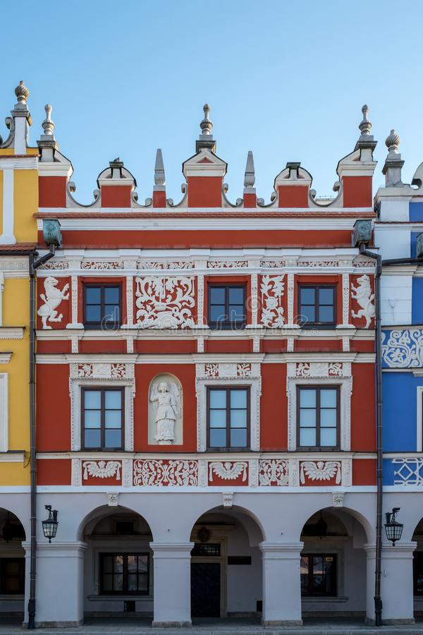 Close up photo of brightly coloured renaissance buildings in the historic Great Market Square in Zamosc in southeast Poland. stock image