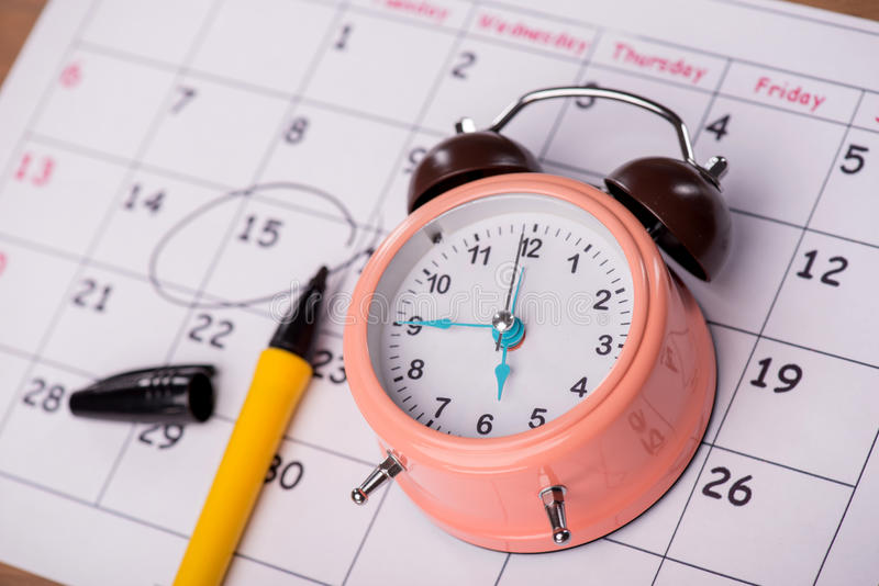 Close-up photo of calendar with a datum circled. Close-up top-view photo of calendar with a datum circled with a black marker lying on it, with selective focus stock photo