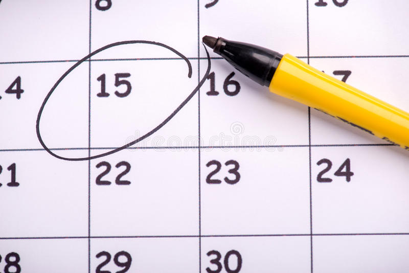 Close-up photo of calendar. Close-up top-view photo of calendar with a datum circled with a back marker, concept of time management at work stock photos