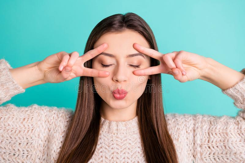 Close up photo of calm flirty lovely girl make v-signs send air kiss attract boyfriend have date wear pullover isolated. Close up photo of calm flirty lovely royalty free stock photography