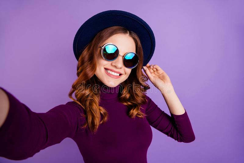 Close up photo of charming lady make photo video call touch accessory isolated over purple violet background stock images