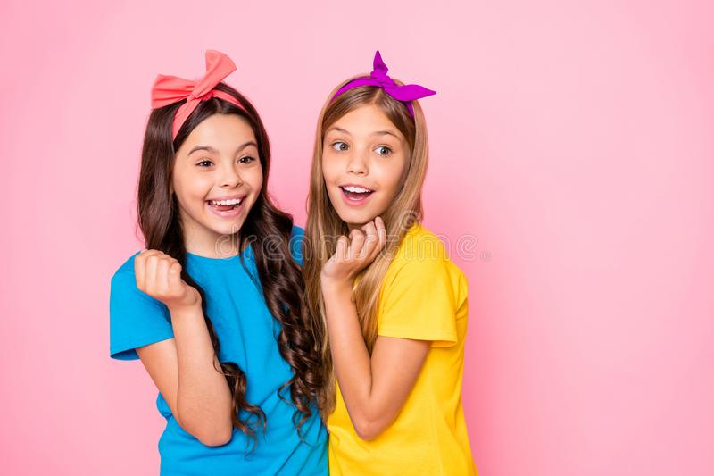 Close up photo of cheerful fellows have t-shirt free time laugh isolated over pink background. Close up photo of cheerful fellows, have t-shirt free time laugh stock image