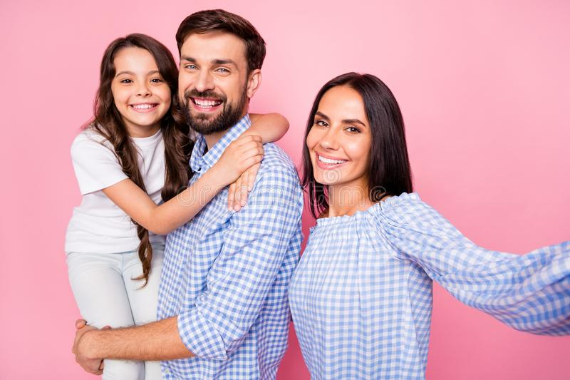 Close up photo of cheerful people making photo memory wearing checkered shirt t-shirt isolated over pink background stock photo