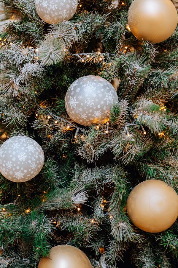 Close-up photo of christmas festive decoration with candles, white golden balls and christmas tree. Close-up photo of christmas festive decoration with candles stock photo