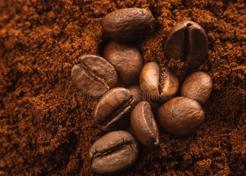 Close up photo of Coffee beans and ground coffee. royalty free stock photography