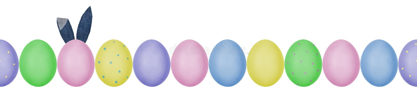 Close up photo of colorful painted Easter eggs with eggshell texture arranged in a row. One egg with denim textile bunny ears. royalty free stock photo