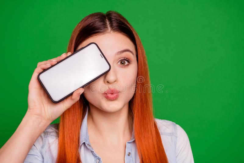 Close up photo content cute charming youth hide eyes modern technology flirt flirty attract boys send air kisses elegant stock images
