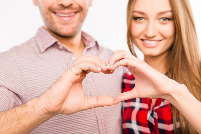 Close up photo of couple in love making heart with fingers royalty free stock image