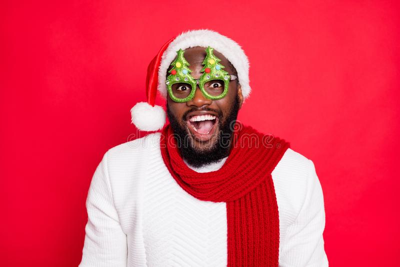Close up photo of crazy funny emotion expression mulatto hipster guy wear christmas tree specs get present prepare. Newyear, theme party dressed white pullover royalty free stock photo