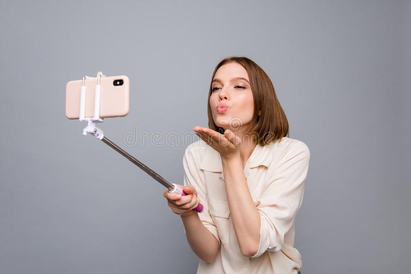 Close up photo cute amazing beautiful she her lady hold hands arms metal telephone stick make take selfies send air kiss stock image