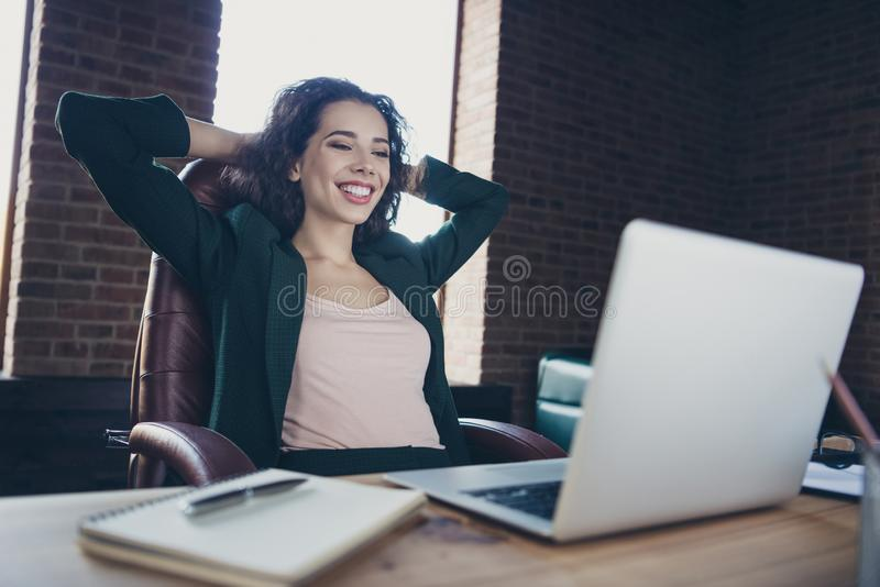 Close up photo of cute funny charming real estate agent enjoy leisure feel glad content have news in modern technology. Sit armchair jacket place hands arms stock photography