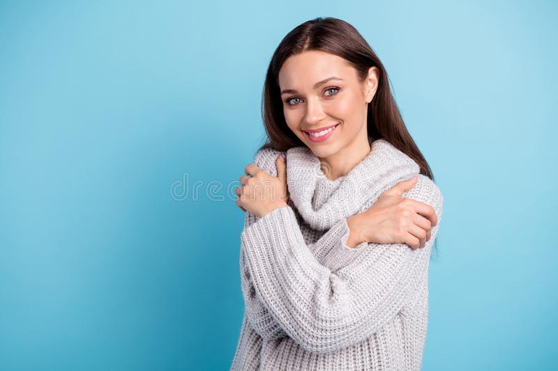 Close up photo of cute lovely girl hug herself enjoy have rest relax wear white knitted pullover sweater with collar. Close up photo of cute lovely girl hug royalty free stock photography