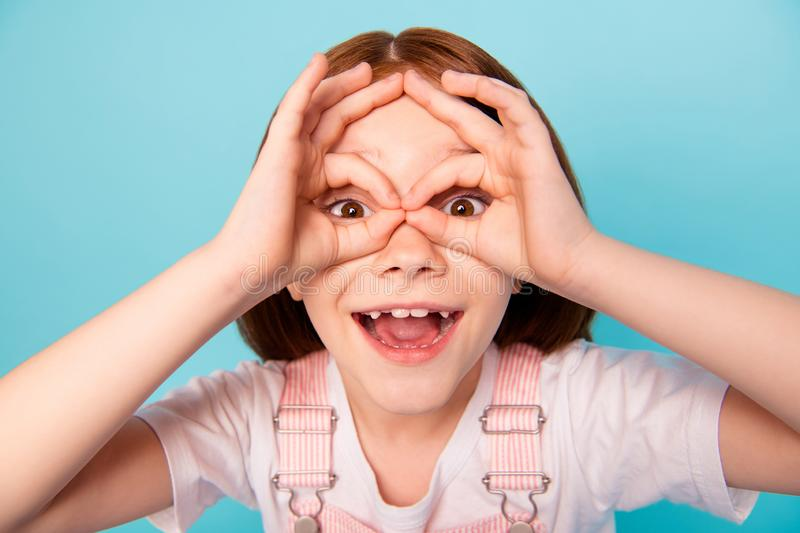 Close up photo cute sweet child laugh laughter fooling make faces binoculars isolated blue background. Close up photo cute sweet, child laugh laughter fooling stock photography