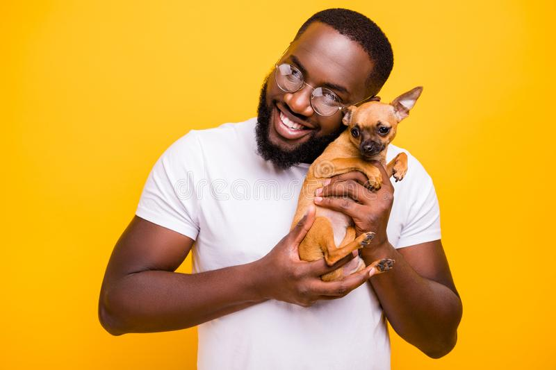 Close up photo of dark skin guy in love with little god in hands wear casual outfit isolated yellow background stock photos