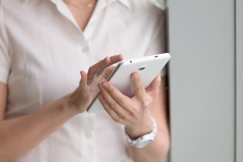 Close up photo of digital tablet in womans hands royalty free stock photos