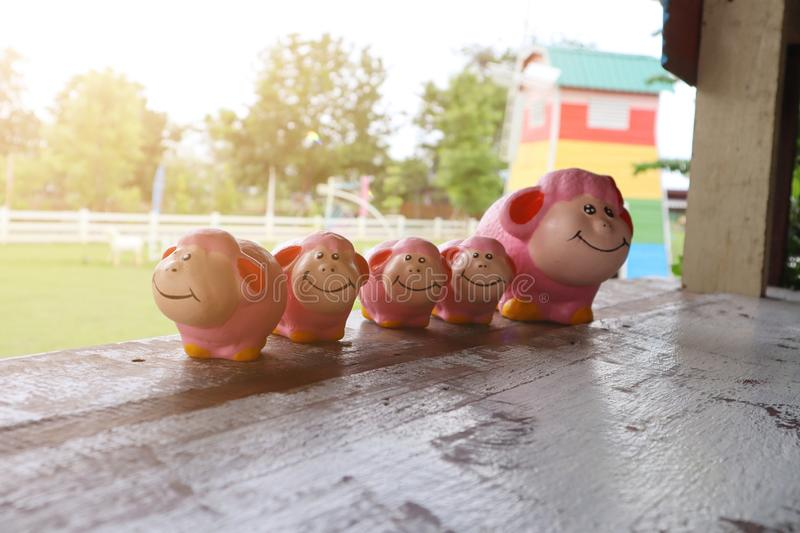 Close-up photo, doll, stucco, pink sheep on the balcony, natural background, sky, morning sun royalty free stock photo
