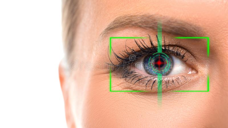 Close-up photo of female eye with the virtual hologram on her eyes. Iris identification and eyesight laser correction. Concept stock photography