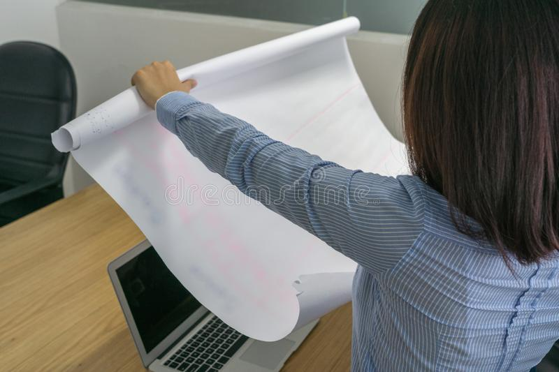 Close up photo of female hand holding project drawing paper royalty free stock photography