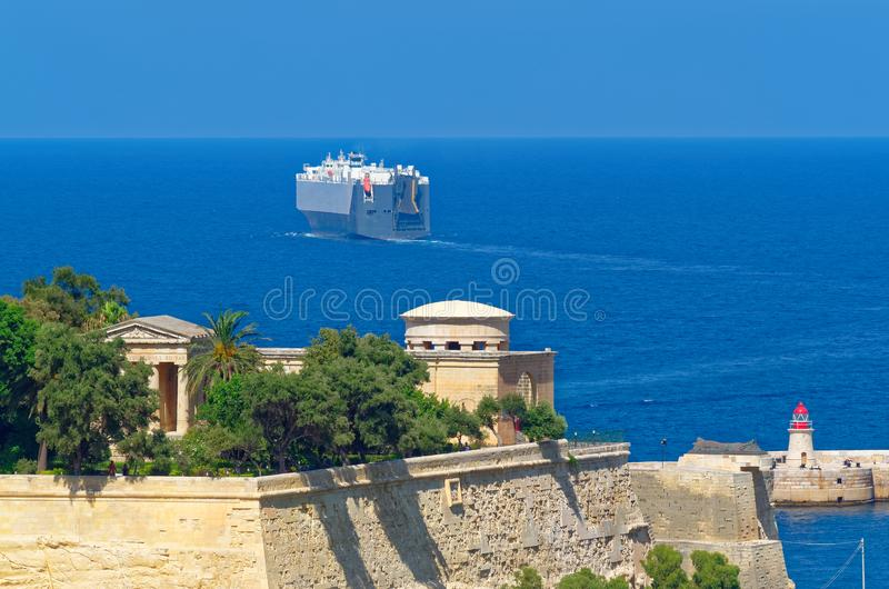 Close up photo of a ferry leaving a harbor of Malta. Ferry leaves a harbor of Malta, view from Valletta. Close up view stock photography
