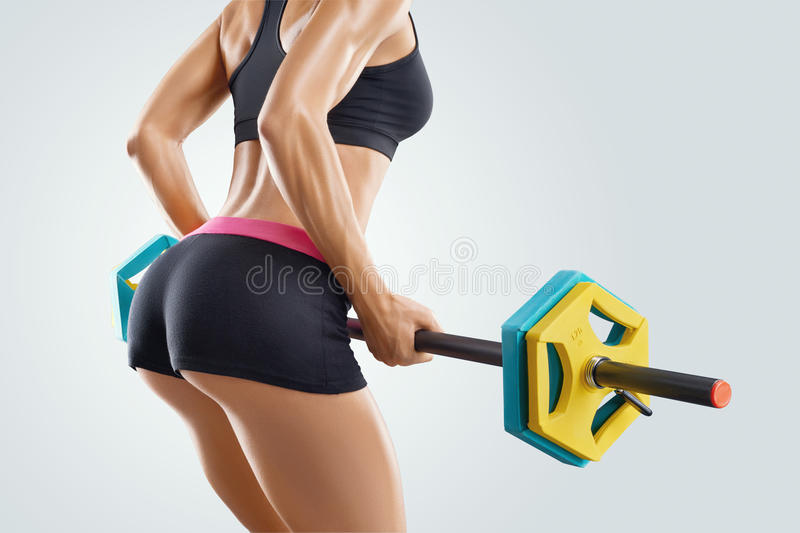 Close up photo of fitness woman workout with barbell at gym stock photography