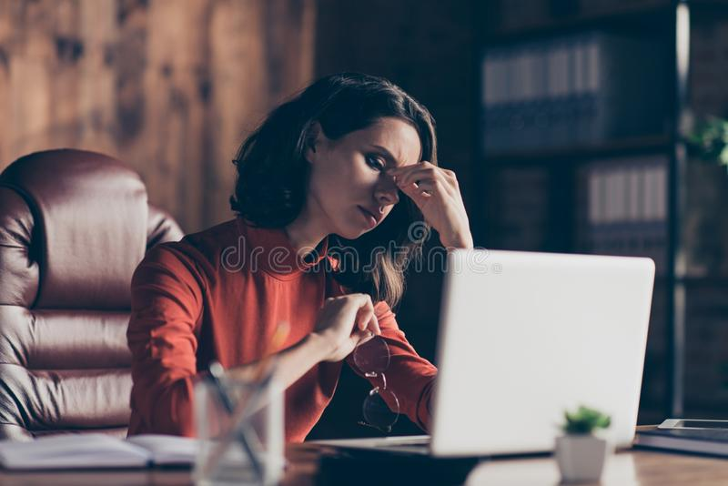 Close up photo focused thoughtful financier finance stress exhausted use device decide solve review touch nose brunette. Style stylish trendy specs red outfit royalty free stock images