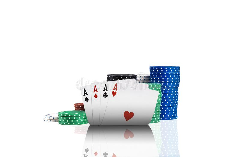 Close-up photo of four aces and colorful chips in piles standing behind, isolated on white background. Gambling. Entertainment, poker, casino concept royalty free stock photos