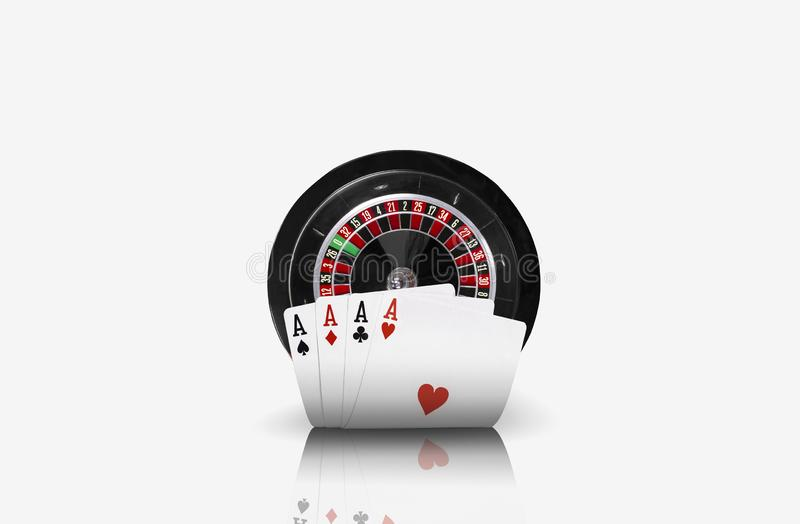 Close-up photo of four aces standing ahead of a black roulette, isolated on white background. Playing cards. Gambling. Entertainment, poker, casino concept stock image