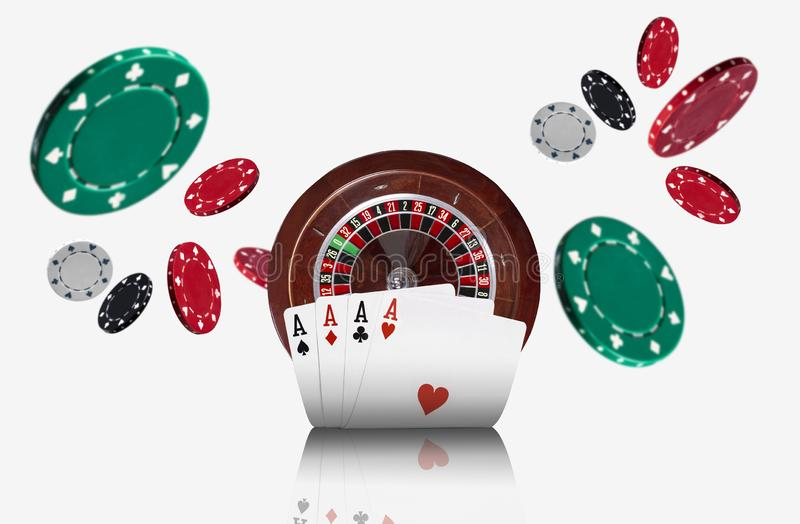 Close-up photo of four aces standing ahead of a brown roulette and chips which flying apart, isolated on white. Close-up photo of four aces standing ahead of a royalty free stock images