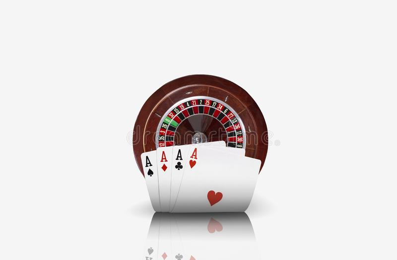 Close-up photo of four aces standing ahead of a brown roulette, isolated on white background. Playing cards. Gambling. Entertainment, poker, casino concept stock images