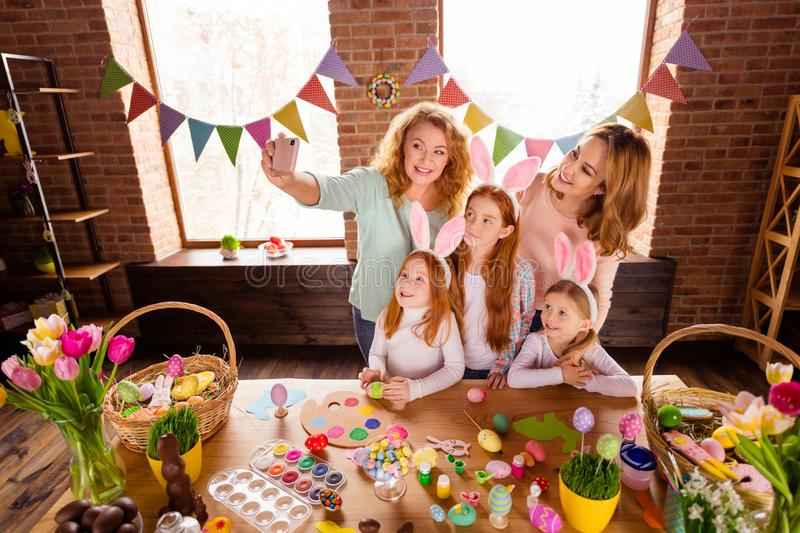 Close up photo foxy three small girls children day easter two mommy pretty table full handmade craft big wooden have royalty free stock photos