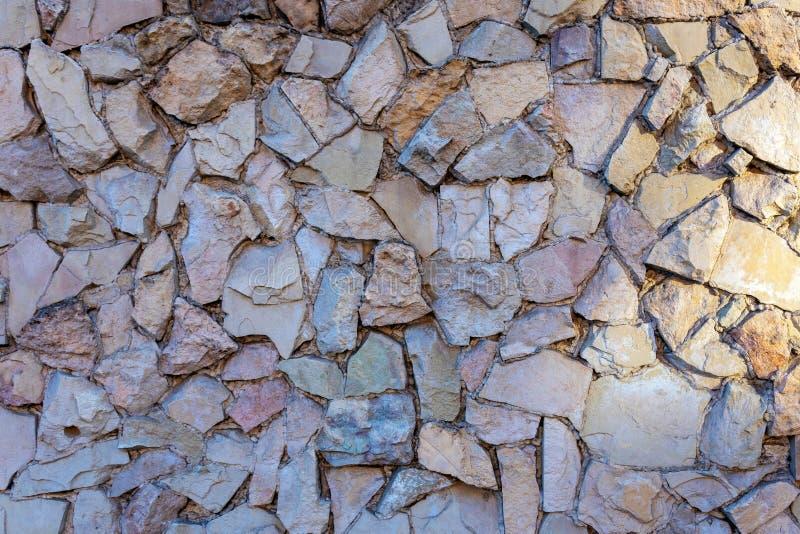 Close-up photo. Fragment of masonry wall with decorative stone trim royalty free stock photo