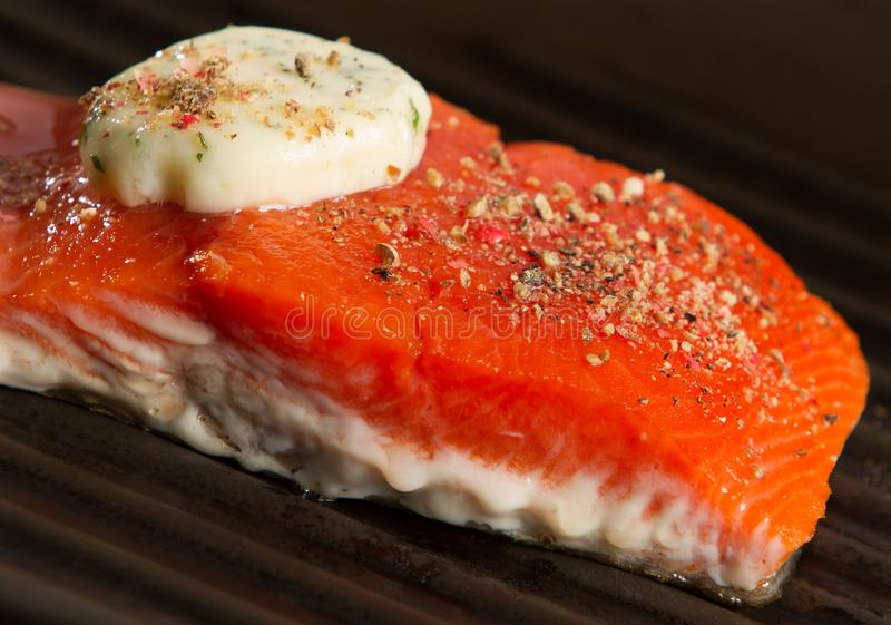 Grilling Fresh Salmon Fillet Close Up royalty free stock photo