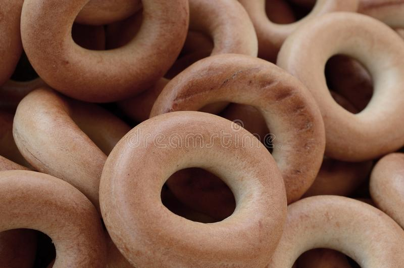 Close-up photo of fresh yellow bagels. A popular kind of flour p royalty free stock image