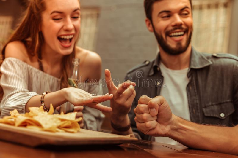 Close-up photo of friends sharing a laugh and playing games stock photos