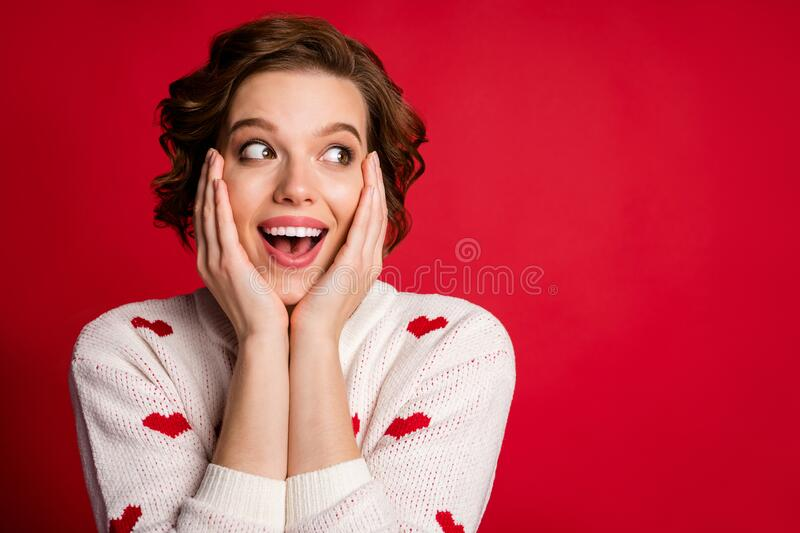 Close up photo of funny crazy astonished girl look incredible romantic information impressed scream wow omg touch face. Close up photo of funny crazy astonished stock photography