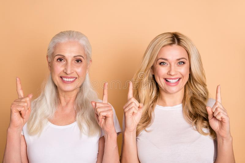 Close up photo of funny cute excited adults ladies curly hairdo decide choose advise adverts news present look way tip. Attention notice advertising wear trendy royalty free stock photos