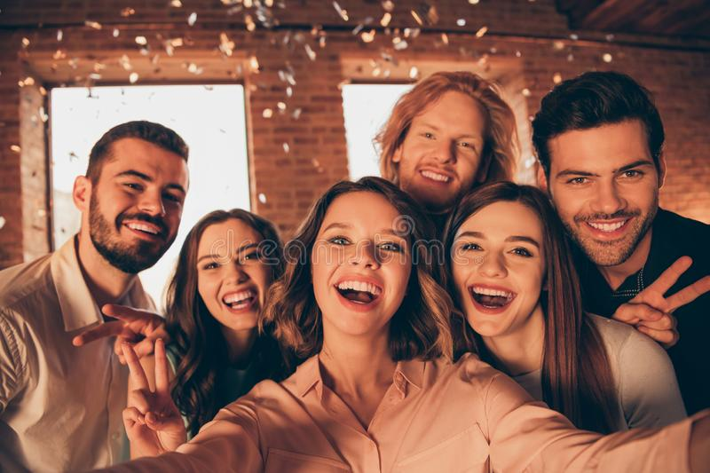 Close up photo gathering friends event hang out drunk people make take selfies show v-sign night life festive she her royalty free stock image